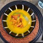 Sweet Pumpkin soup with pesto and pumpkin crisps.