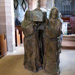 Wood carving of monks bearing a coffin