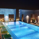 Swimming pool with rooftop bar