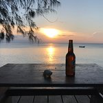 Sunset with dive boat and Kilimanjaro beer.