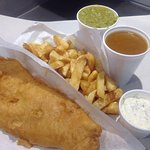 Cod and chips, mushy peas, curry sauce and home made tartare sauce