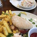 Chicken Burger that comes with chips, salad and coleslaw