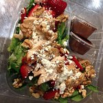 Strawberry fields salad with chicken and house balsamic dressing.