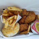 Chicken strip combo with fries and a biscuit