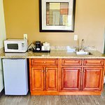 Wet Bar with Italian Granite Counters & Micro-Refrigerator and Coffee in our Spacious King Suite