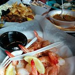 Peel and eat shrimp, soft shell crabs, and gumbo. Everything served in single use.