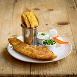 Coworth Park beer-battered haddock, chunky chips and minted peas