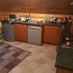 Kitchen area, fridge, cooker and dish washer (this is upstairs in the property)
