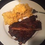 Ribs, chicken, cornbread mac & cheese and collard greens.