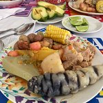 A typical country Colombian dish with various potatoes, tubers, and meats. Try this or other dis