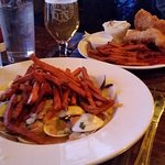 Steamed clams and sweet potato fries in foreground, Fish n Chips with sweet potato fries in back