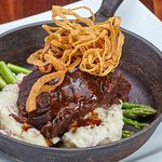 Braised Natural Beef Short Ribs served with jumbo asparagus and garlic mashed potatoes.