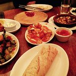 a table full of bread and tapas