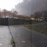 Vietnam Veterans Memorial Wall so high reflective the top disappears into the sky