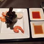 Starter with shrimps and beetroot chili sate sauce
