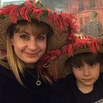 Trying on the Moroccan hats!