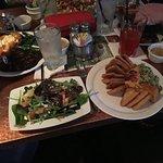 Half greek salad and hummus appetizer and lemonade