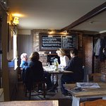 A fire in the grate and scrubbed wooden tables give authenticity to the bar of the Sussex Brewer