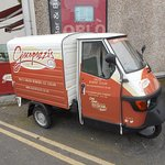 Small delivery van outside the shop