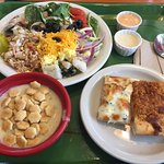 Salad, corn chowder, and pizza