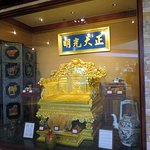 emperor chair (Chair of the Dragon) on display in Beijing Restaurant window
