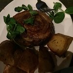 The signature roast pork with rosemary potatoes