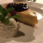 Key lime pie with berries and heavy whipped cream.