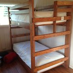 Three sets of bunk beds. Two sets in a private room.