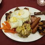 Mixed grill with garlic potatoes,steak,gammon,pork,lamb,and sausage,blackpudding and an egg
