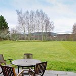 Outdoor area of Cairngorm View - self-catering cottage for rental in Hotel grounds