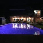 View of pool at night, from the beach side