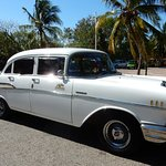 Chevvy Belair Taxi. Always negotiate before getting in a cab.