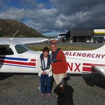 Photo of us taken by James the pilot next to our plane.