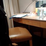 chair too high to enable average adult to fit legs under desk