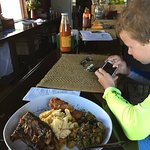 My son plays some videos before we devour our shared lunch plate...