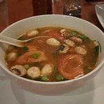 Tom Yum Lemon grass soup with mushrooms, onions and tomatoes with chicken.