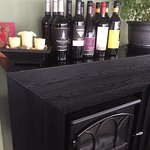 Wine selection displayed over fireplace, Beach House Cafe, 2775 Island Hwy, Qualicum Beach,
