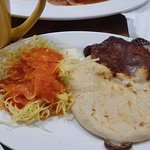 Cheese/loroco pupusa and green cabbage with tomato sauce