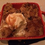 such a yummy dessert. bread pudding with caramelized topping and a scoop of vanilla ice cream. Y