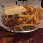 Boiled crawfish bucket, charcoal grilled oyster, catfish sandwich, gumbo