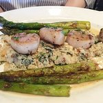 Scallops special with couscous and sliced almonds with asparagus