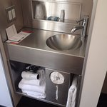 Single pod sink, in room w/bathrooms down the corridor.