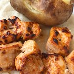 Lebanese chicken skewers with baked potato
