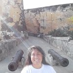 in front of some canons by the entrance