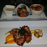 Coconut crusted lionfish with potato gratin, sauted vegetables and ginger sauce