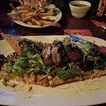 Steak Bruschetta with fries in the background