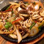 Sizzling octopus? Looks like squid to me 😉