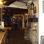 A welcome as warm as the log fire blazing in the hearth greets visitors to the Bridge Inn @ Ambe