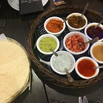 Popadoms with many different sauces. Nahari lamb curry Garlic naan