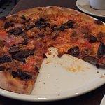 Fennel, portobello mushroom pizza with tomato sauce added